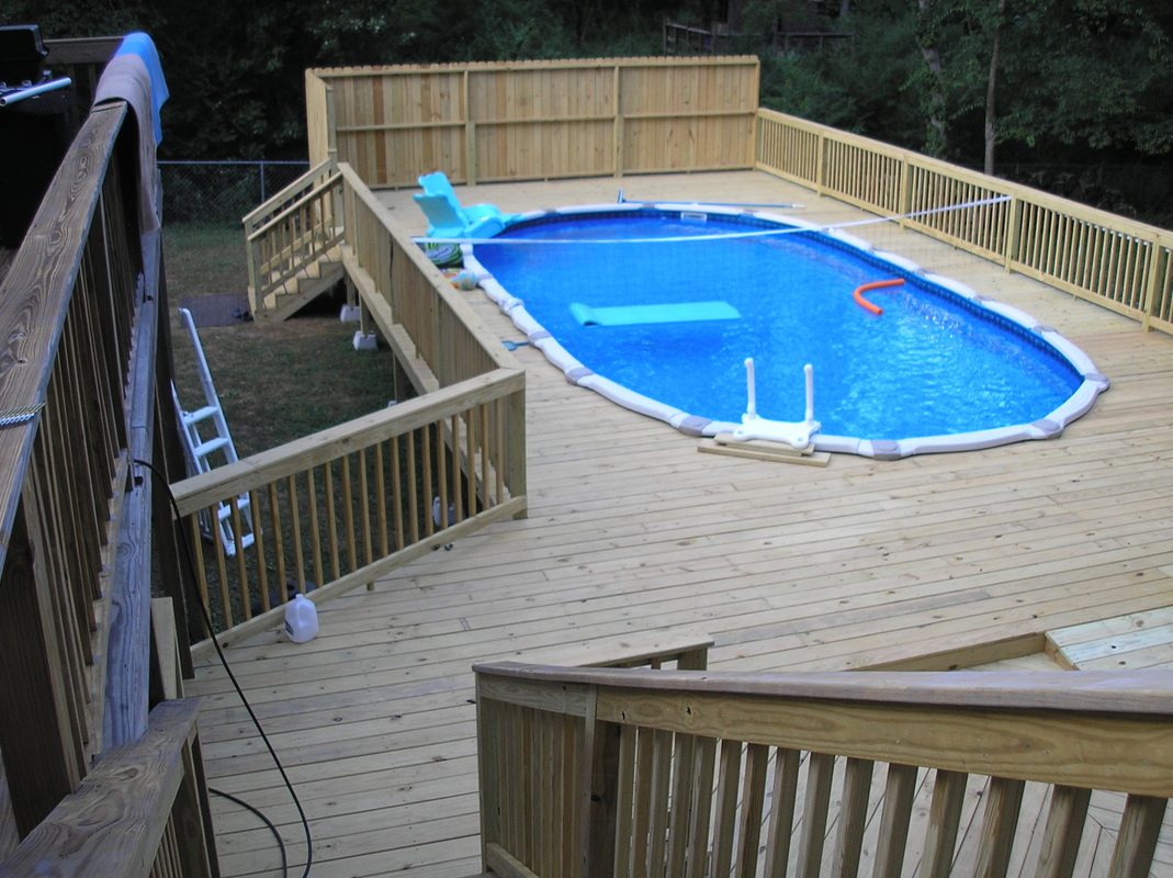 this deck was built around an above ground pool it was connected to the steps at the back door our client needed the deck handicap accessible